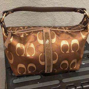 Bronze coach purse